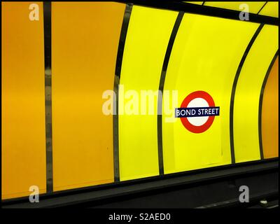 """Colourful Signage on the London Underground (Tube) System indicating this station is """"BOND STREET."""" This station is on the Central & Jubilee Lines. Photo Credit - © COLIN HOSKINS. - Stock Image"""