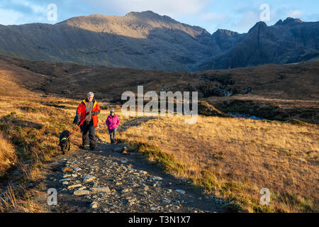 Footpath leading to and from the Fairy Pools with the Cuillin Hills in the background, Isle of Skye, Highland Region, Scotland, UK - Stock Image