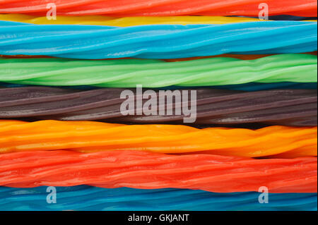 colorful licorice candy shaped like a twisted rope background - Stock Image