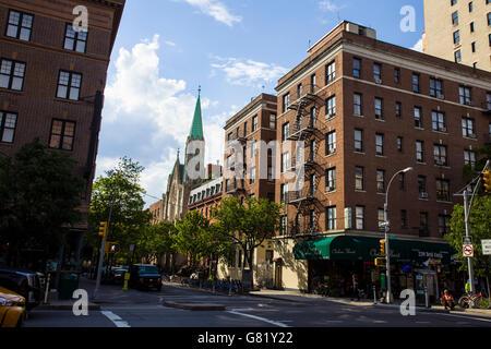 A quiet street in upper Manhattan - Stock Image