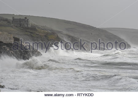 Porthleven, Cornwall, UK. 3rd Mar 2019. UK Weather. Storm Freya brings in huge winds and waves on the Cornish coast at Porthleven this aftrnoon Credit: Simon Maycock/Alamy Live News - Stock Image