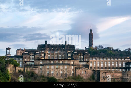 Edinburgh grand buildings in Winter dawn. St Andrews House, Scottish Government headquarters, and Calton Hill monuments - Stock Image