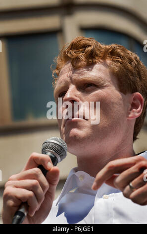 U.S. Democratic Representative Joseph Patrick Kennedy III (Joe Kennedy), grandson of Robert Kennedy and grand-nephew of John F. Kennedy speaking at Boston City Hall during the Rally against Family Separation in Boston, MA. Kennedy spoke against U.S. President Donald Trump's policy of detaining immigrants and separating immigrant families.  Large rallies against President Trump's policy of separating immigrant families took place in more than 750 U.S. cities on June 30th of 2018. Chuck Nacke / Alamy Live News - Stock Image