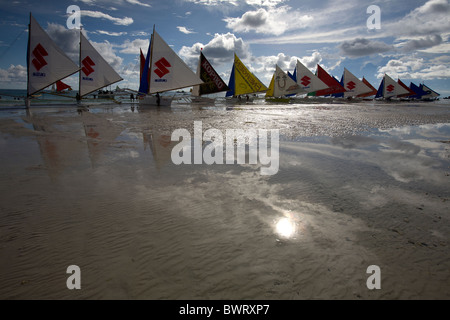 Sailboats line the shore on Long Beach in the late afternoon in Boracay, Philippines. - Stock Image