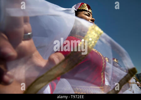 A girl wearing national costume during Hidirelez holiday, a celebration of spring and fertility, in Bakhchysarai, Crimea - Stock Image