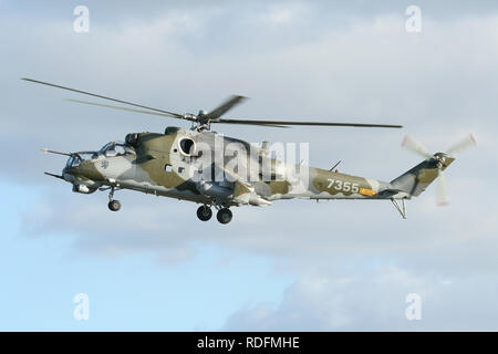 Czech Air Force Mil Mi-35 Hind attack helicopter landing at Wattisham airfield in Suffolk whilst enroute to an air show in Scotland. - Stock Image