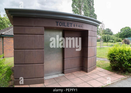 A coin-operated public toilet in Bellevue Park Wrexham Wales June 2018 - Stock Image