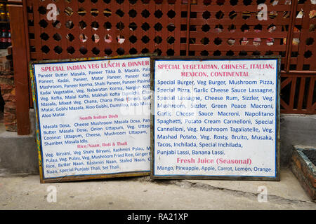 Menu in English displayed outside a restaurant in Pokhara, Nepal. - Stock Image