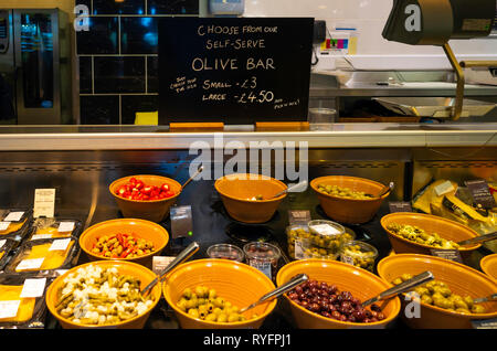 A view of the display of the self-service Olive Bar in Booths Supermarket Ripon North Yorkshire England UK - Stock Image