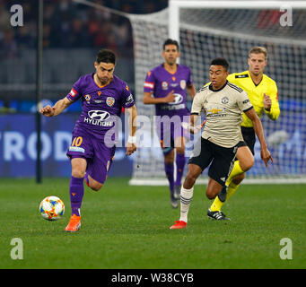 Optus Stadium, Perth, Western Australia. 13th July, 2019. Pre-season friendly football, Perth Glory versus Manchester United; Bruno Fornaroli of Perth Glory runs clear of Jesse Lingard of Manchester United Credit: Action Plus Sports/Alamy Live News - Stock Image