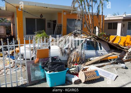 Damaged homes and vehicles from tidal surge flooding in the aftermath of Hurricane Maria November 1, 2017 in Humacao, - Stock Image