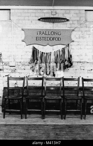 Chairs & prize bags on stage at Trallong small eisteddfod in Sennybridge Market Hall Powys Wales UK - Stock Image
