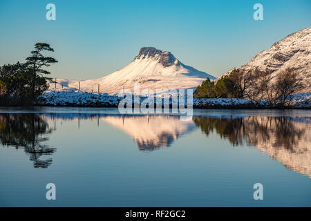 Reflection of Stac Pollaidh in winter covered in snow, Inverpolly, Assynt, Wester Ross, Scottish Highlands, Scotland, UK, Europe - Stock Image