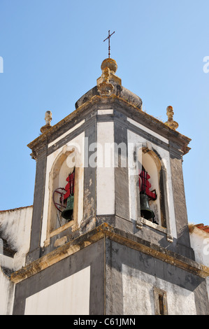 Church bell in tower in the medieval town of Obidos some 50 miles north of Lisbon, Portugal - Stock Image