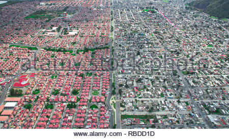 Ixtapaluca, Mexico City. AMAZING aerial images have captured the stark contrast and inequality where rich meets poor all across the world. The spectacular bird's eye view pictures show the landscape as an affluent area gives way onto one where people may be suffering from poverty. The stunning shots show this crossover of the rich and poor all across South Africa, Kenya, Mexico and even the USA. The remarkable photographs form of africanDRONE founder and photographer Johnny Miller's (37) Unequal Scenes project. Johnny Miller / mediadrumimages.com - Stock Image