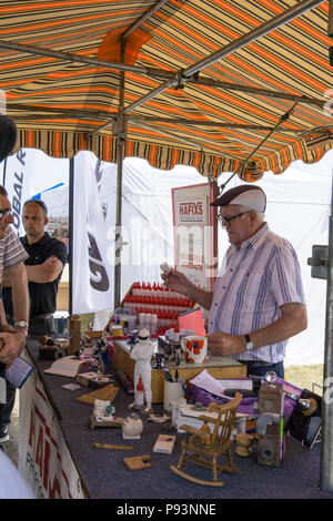 Demonstrating glues at Wings and Wheels - Stock Image