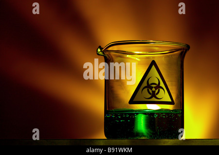 Liquid filled laboratory beaker with biohazard symbol - Stock Image