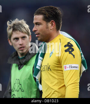 Aaron Hunt (L) and goalkeeper Tim Wiese of Bremen are disappointed after the Bundesliga match Hanover 96 vs Werder - Stock Image