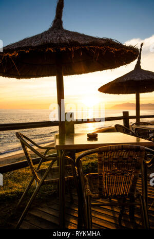 Terrace with parasols during sunset on the Costa del sol, Andalusia, Spain - Stock Image