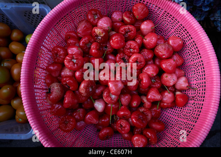 Balinese rose apple fruit being sold at the Ubud Markets Indonesia - Stock Image