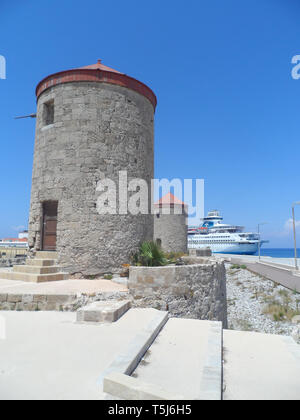 Windmill ruins at Mandraki harbour, Rhodes Old town, Greece - Stock Image