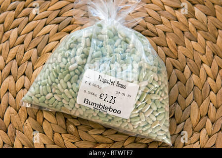 Flageolet Beans in polythene bag with shop label. - Stock Image