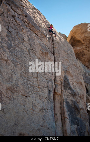 young girl rock climb climbing wall risk sport extreme outdoor nature - Stock Image