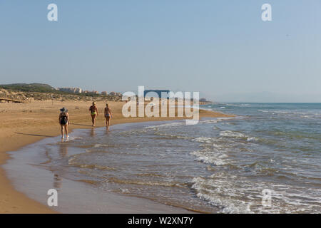 People walking on beautiful natural beach between Torre La mata and Guardamar de Segura Costa Blanca Spain - Stock Image