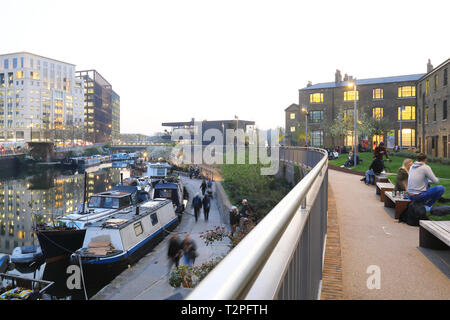 Wharf Road Gardens at dusk in spring, leading to Granary Square at Kings Cross, London, UK - Stock Image