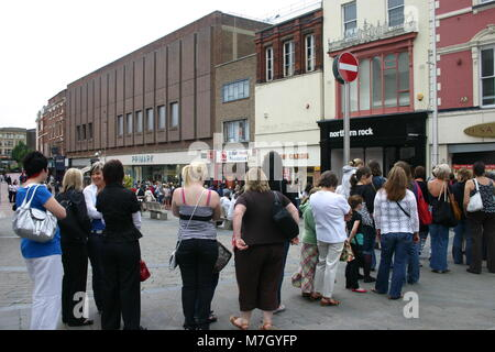 The sales, with female customers queuing outside Primark, Derby, UK - Stock Image