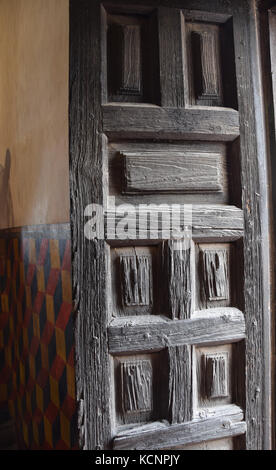 Old wooden door leads to Mission San Xavier in Tucson, Arizona - Stock Image