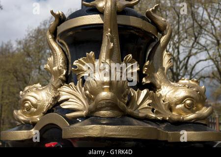Golden fish detail on a street light on Victoria Embankment in London UK - Stock Image