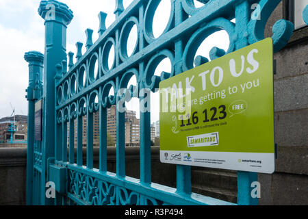 The Samaritans sign on blue gate in London, UK - Stock Image