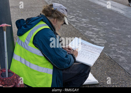 Artist on London's South Bank doing a drawing of the Globe Theatre, London, UK - Stock Image