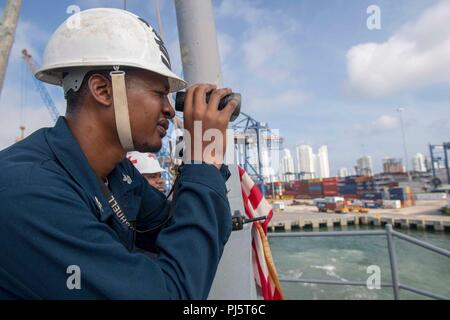 180827-N-GX781-0019 CARTAGENA, Colombia (Aug. 27, 2018) Boatswain's Mate 1st Class Lester Jones tracks the distance to the pier as the Whidbey Island-Class Dock Landing Ship USS Gunston Hall (LSD 44) pulls in to Cartagena, Colombia for a scheduled port visit. The ship is on deployment supporting Southern Seas, which is an annual collaborative deployment in the U.S. Southern Command area of responsibility where a task group will deploy to conduct a variety of exercises and multinational exchanges to enhance interoperability, increase regional stability, and build and maintain regional relations - Stock Image