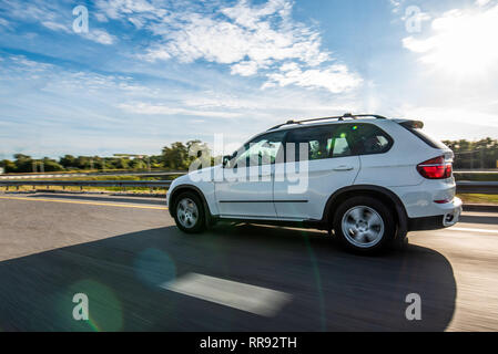 White suv on the road with speed effect - Stock Image