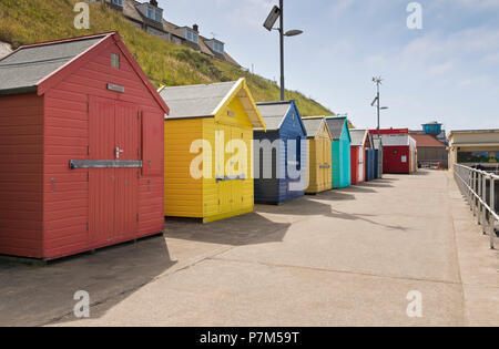 Colourful beach huts on the seafront in Sheringham, Norfolk, UK. - Stock Image