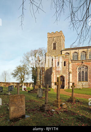 A view of the South Porch and Tower of the parish church of St Mary in South Norfolk at Shelton, Norfolk, England, United Kingdom, Europe. - Stock Image