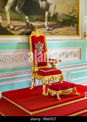 18 September 2018: Peterhof, St Petersburg, Russia - The coronation throne of Nicholas I in the Neoclassical Throne Room of Peterhof Palace. - Stock Image