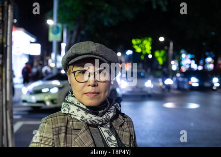 Fashionable Taiwanese woman of Chinese ethnicity out on town in the evening - Stock Image