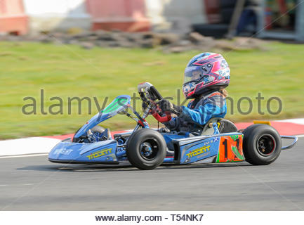 Larkhall, UK. 21st April, 2019. 17 Evi Davidson in the  Bambino class Time Trial  during Round 2 of the 2019 WSKC Club Championship at Summerlee Raceway. Credit: Roger Gaisford/Alamy Live News - Stock Image
