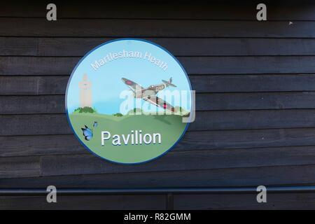 Pavilion sign featuring a spitfire in recognition of RAF Martlesham's WWII history. Martlesham Heath, Suffolk, UK, December 2018. - Stock Image
