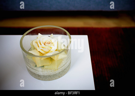 Flower in a glass bowl - Stock Image