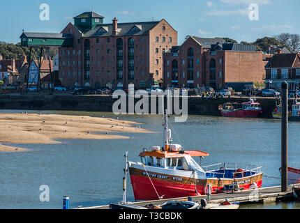 Port and Harbour of Wells-next-the-Sea with distinctive old granary building, Norfolk, United Kingdom. - Stock Image