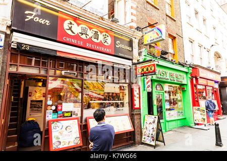 China Town London UK, China Town London, China Town, China Town restaurants London UK, China Town restaurant London, China Town shops London, England - Stock Image