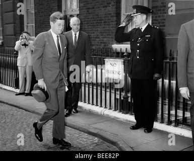 US President John F Kennedy arrives at No.10 Downing Street for a visit with British Prime Minister McMillan. - Stock Image