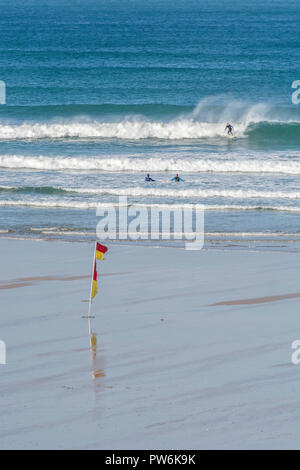 Surfers at Newquay, Cornwall - home of Boardmasters Festival. - Stock Image