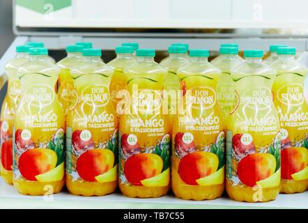 Bottled Mango & Passionfruit fruit juice - Stock Image