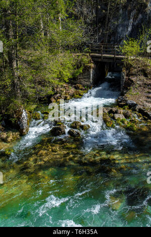 Wild Alpine River With Waterfall And Bridge In Austria - Stock Image