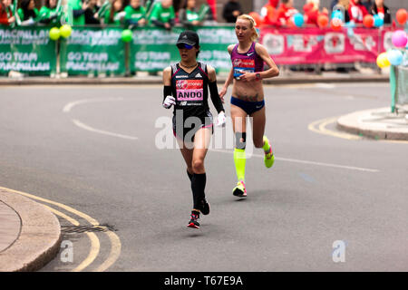 Elite Women athletes, Yuka Ando and Lilla Fiskovici, competing in the 2019 London Marathon. They  finished  in 12th and 13th places respectively. - Stock Image